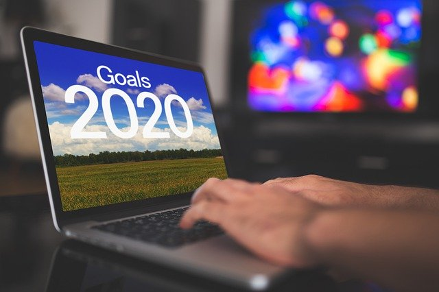 Laptop desktop screensaver with Goals 2020 on top of a countryside scene