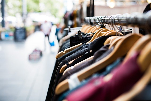 Image of clothes hanging in a shop.
