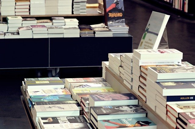 Photo of book copies on display stacked in a store